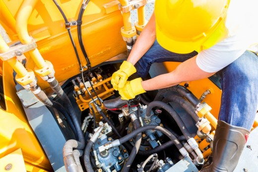 6 reasons to conduct maintenance on your heavy machinery - motor mechanic working in vehicle workshop