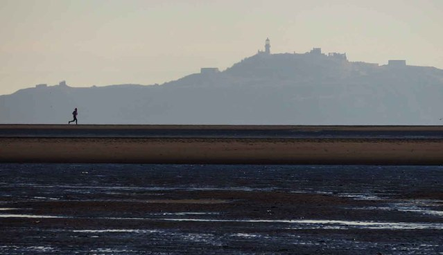 Jogger and Inchkeith. Burntisland Sands