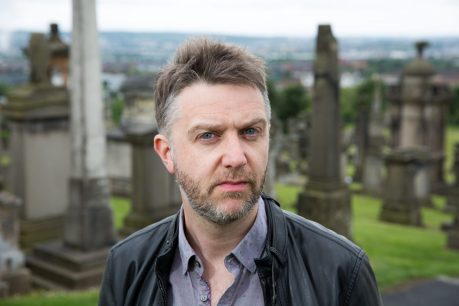 Herald business writer Kevin Scott at the Necropolis in Glasgow with a copy of his new book - Dead Cat Bounce.