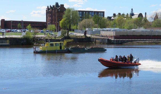 Power Boat and Floating Wood Collector. Govan