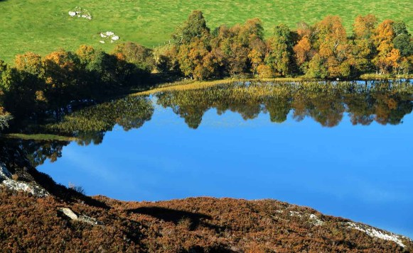 Reflection Curve on Loch Ruthven. Inverness Highlands.