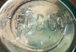 F.C.G.CO. on base of chemical/packer bottle.