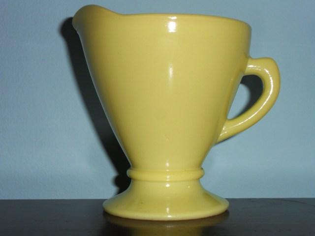 "HAZEL-ATLAS GLASS COMPANY ""OVIDE"" pattern creamer in lemon yellow Platonite, circa 1950s"