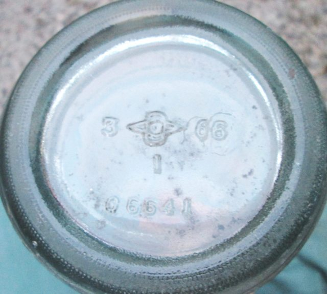 Base of Yacht Club Beverages ACL soda bottle, bearing 1966 date code along with older mark. (Photo courtesy of Taylor McBurney)