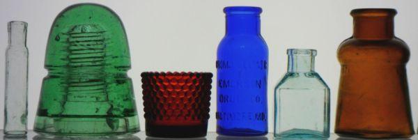 Small glass medicine vial; Telegraph insulator; Hobnail votive candle holder; Bromo-Seltzer bottle; Square ink bottle; Bixby Shoe polish bottle
