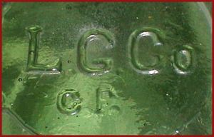 """L G CO / CF"" mark on base of yellow-green wax sealer fruit jar made by Lindell Glass Company, Saint Louis, MO."