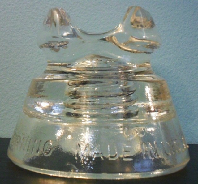 "CD 233 style power line insulator. Marked ""PYREX REG. U.S.PAT.OFF. // 661 / CORNING MADE IN U.S.A."""