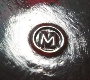 "Mosser Glass Company - ""M inside a circle"" mark on the base of ruby red toothpick holder/votive candleholder."