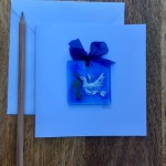 Blank greetings card with tiny fused glass dove suncatcher