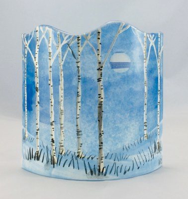 Blue fused glass curved panel of silver birches in moonlit snow scene