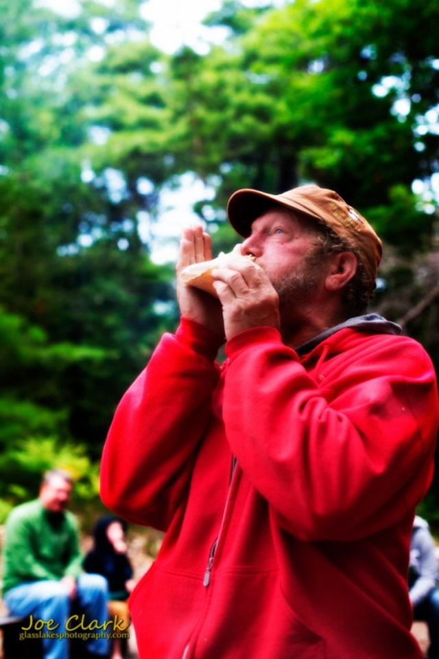 Norm Wheeler starts the bards with his conch shell by Joe Clark www.glasslakesphotography.com