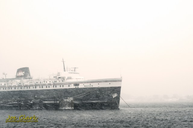 S.S. Badger sits covered in snow in Ludington harbor by Joe Clark www.glasslakesphotography.com