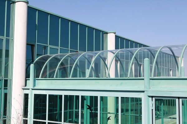 14 Cold bending makes it possible to place curvatures on glass immediately before installation. (Photo credit: Lisec Austria GmbH)