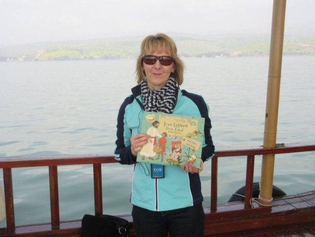 Glenys with book on boat