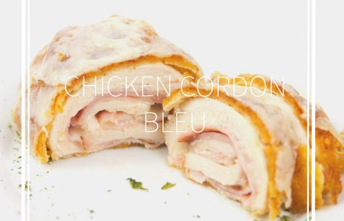 white plate of cut down the middle cordon bleu with ham and cheese inside chicken breast