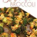 baking pan of cooked broccoli with sriracha sauce