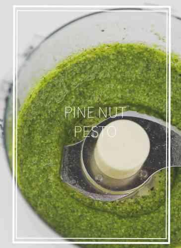 food processor bowl with green basil pine nut pesto