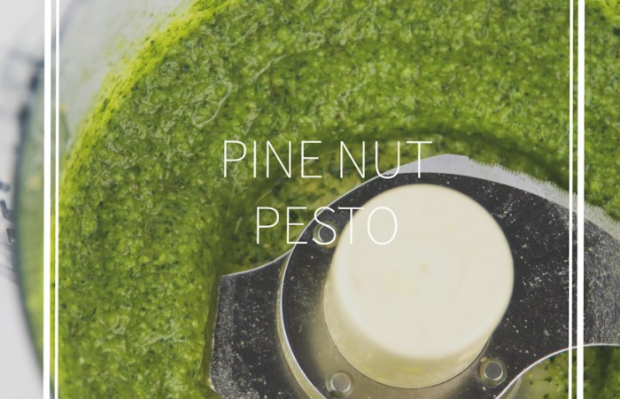 food processor bowl with green basil pine nut pesto