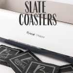 a cricut maker with black slate personalized coasters