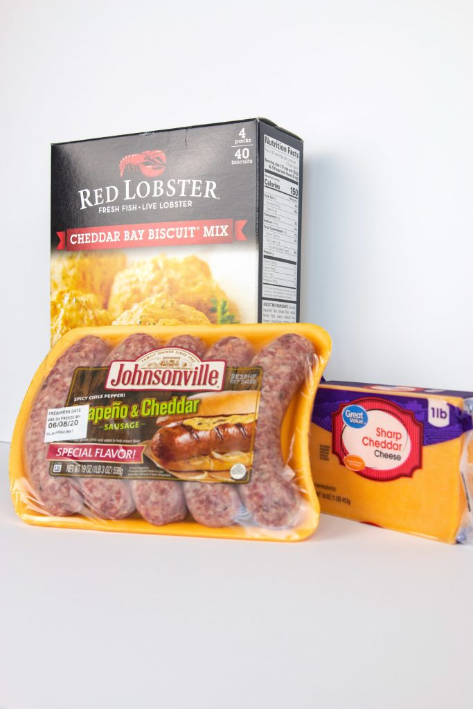 ingredients to make jalapeno cheddar sausage balls with jalapeno cheddar sausage, shrap cheddar cheese and red lobster biscuit mix