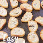 a sheet pan of slice baguette bread toasted for easy crostini