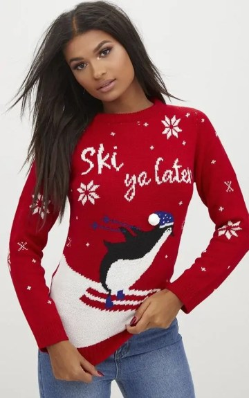 some of the best christmas jumpers to get you in the festive sprit prettylittlething red penguin pom pom jumper
