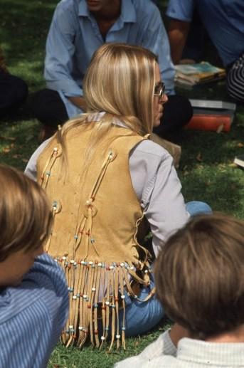 Student wearing a hippie-inspired buckskin vest.