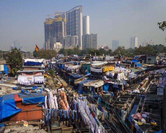 Contrasts of Mumbai - laundry at Dhobi Ghat against a backdrop of a modern highrise
