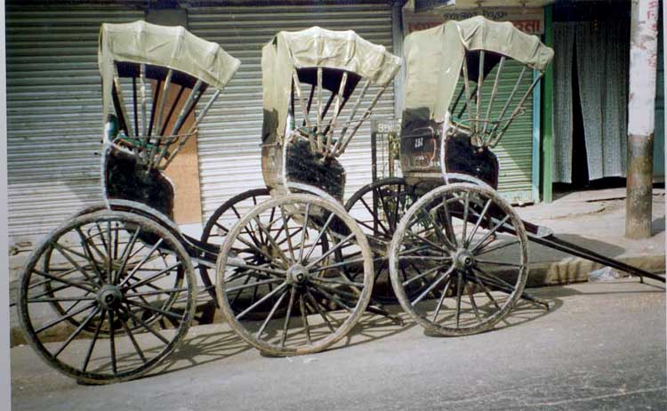 Handpulled rickshaws in Calcutta. Photo Credit: http://www.indiamike.com/