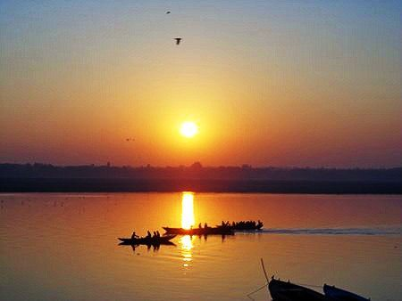 sunrise over the Ganges river in Varanasi