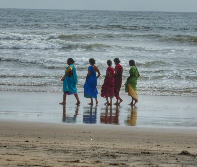 Indian Ladies Take A Stroll On An Almost Desert Arambol Beach In Monsoon Season