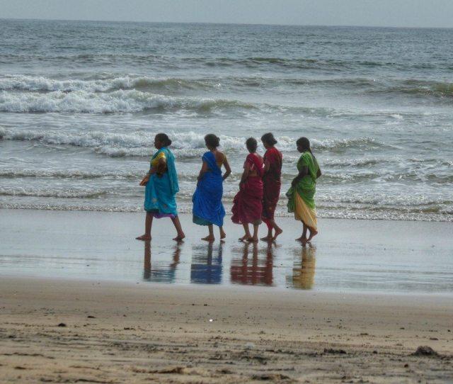 Indian Ladies Take A Stroll On An Almost Desert Arambol Beach In Monsoon Season