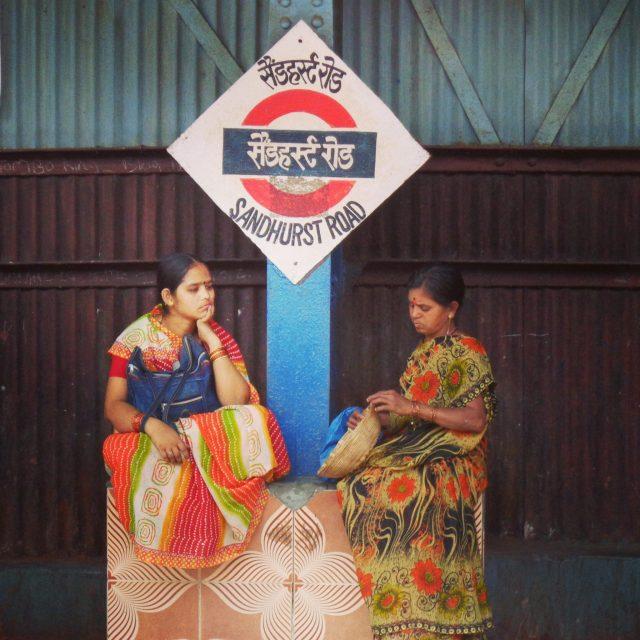 Ladies waiting at a train station in Mumbai