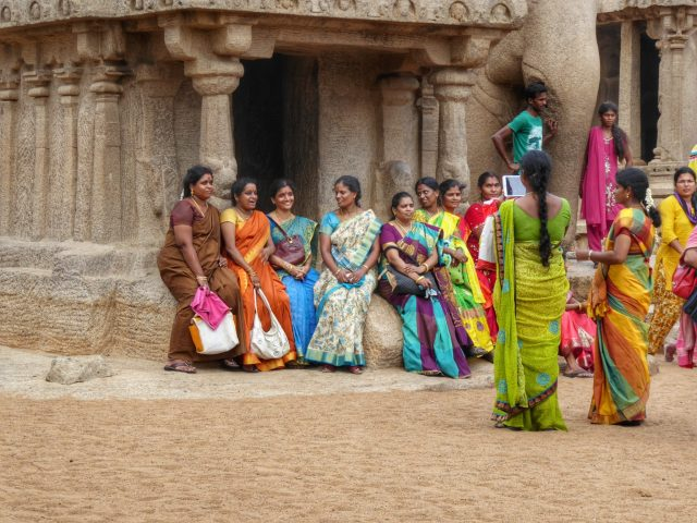 Women in colourful saris at the temples in Mahabalipuram in Tamil Nadu