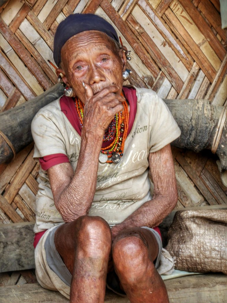 Konyak woman - notice the tribal tattoos on her legs