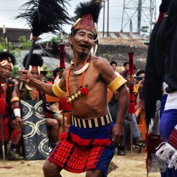 Headhunter man dancing at the Aoling festival in Nagaland, North East India