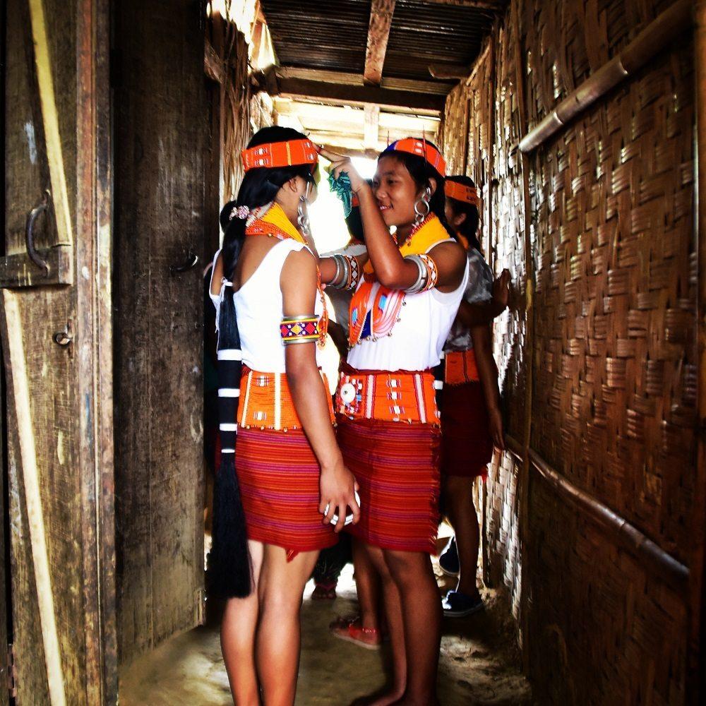 Konyak girls getting ready for the Aoling festival in Mon, Nagaland