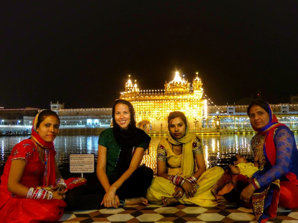women at golden temple at night