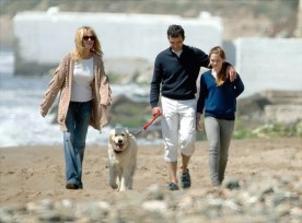 Spanish actor Antonio Banderas and his wife Actress Melanie Griffith and her daughter Stella walking their dog on Marbella's beach. Photo Credit: NY Daily News
