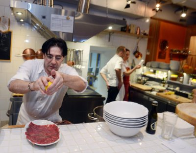 Valentino Bontempi prepares horse meat dishes in a variety of ways at his Moscow restaurant, including raw, pictured, as carpaccio, and filet grilled on coals. Photo credit: James Hill/NYT
