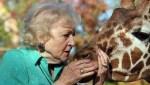 Betty White and giraffe