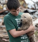 boy holds dog, pet rescues after oklahoma tornado