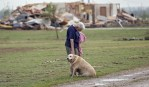 Kay Taylor woman with her dog after oklahoma tornado