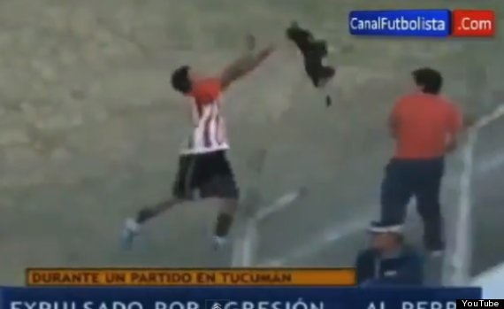 Jose Jimenez aggressively throws a stray dog. Photo Credit: YouTube