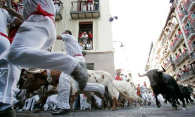 The long held tradition of Running of the Bulls in Spain is now coming to the US with The Great Bull Run. Photo credit: Susana Vera/Reuters