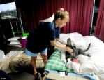 woman and pets in shelter after colorado flooding
