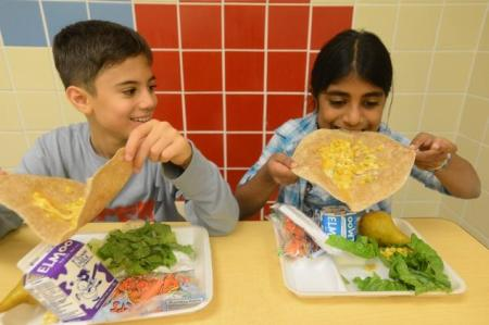 Thomas Gafaro and Vini Chitharanjan, both 8-year-old third graders at P.S. 244 in Flushing, say they like the school's vegetarian lunch offerings, such as the veggie quesadillas./Photo credit: NY Daily News, Aaron Showalter