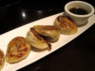 P.F. Chang's vegetarian pan fried dumplings come with a tasty chili sauce for dipping and are a tasty vegetarian alternative to the shrimp and pork versions./Photo credit: Lisa Singer