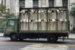 Street artist Banksy makes artwork in New York City to combat factory farming, and animal cruelty.
