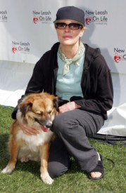 """Actress Kim Basinger attends the 4th Annual """"Nuts For Mutts"""" dog show with the following pet adoption at Pierce College on April 3, 2005 in Woodland Hills, California. Photo Credit: Frazer Harrison/Getty Images"""